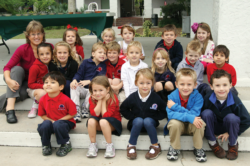 Susan Nations' kindergarten class poses, Wednesday, Nov. 30, in the courtyard at Southside Elementary.