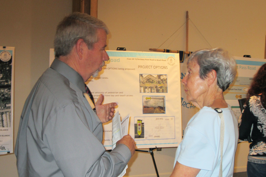 Gary Amig, access management/safety program manager for District One of the Florida Department of Transportation, talks Tuesday evening with Kathy Bell, a resident of the Excelsior condominium complex.