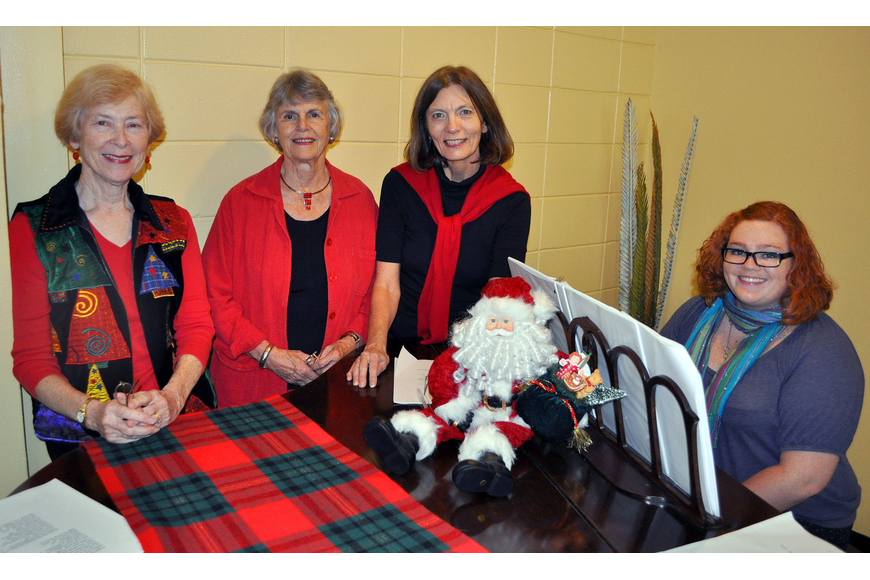Linda Pendray, Debbie Harvey, Peg Davant and Lily Wohl pose around the piano.