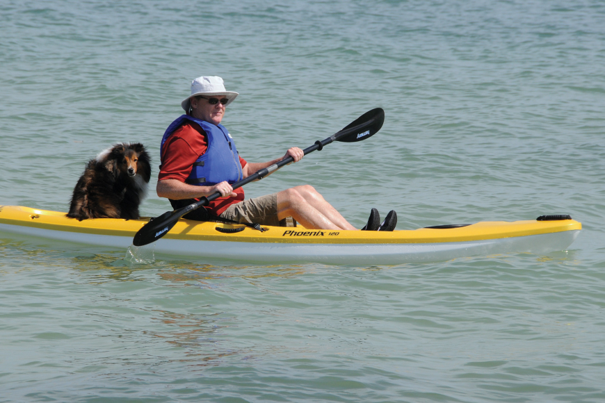 Barry Sullivan takes a trip on his new kayak with his dog, Justice.