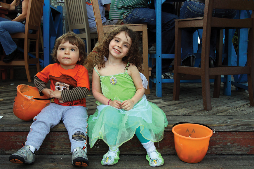August, 2, and April, 4, Turner, took a few minutes to relax on the steps of the Siesta Key Oyster Bar during the Village's annual Safe Treats Halloween event.