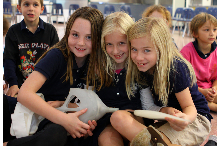 Sara Green, 6, Claire Maag, 6, and Aston Harris, 7, hold one of Winter's tails, Friday, Jan. 20, at Out-of-Door Academy.