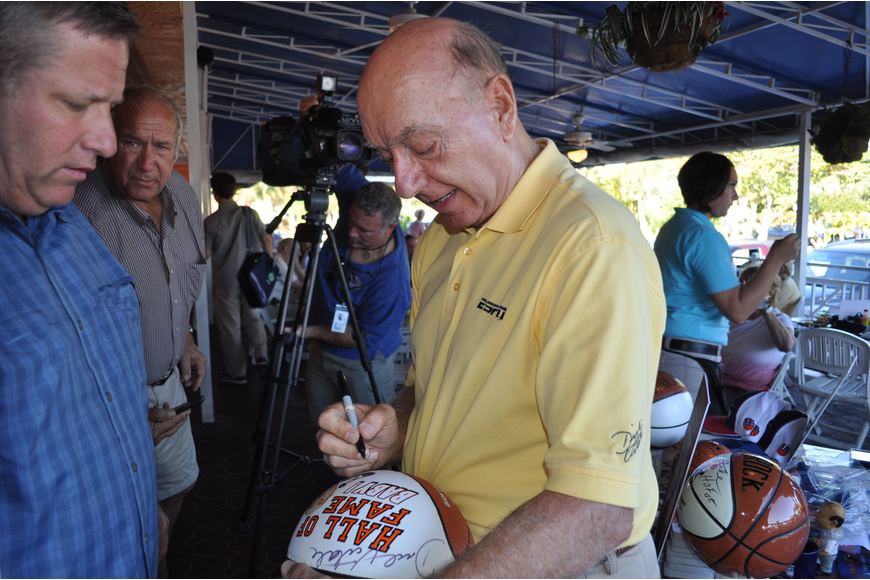 Dick Vitale signs a basketball for Alan Streitmatter.