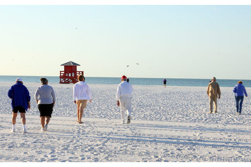 Walkers make their way down to the shore to participate in the Senior Beach Walk, Wednesday, Feb. 1, on Siesta Key Beach.