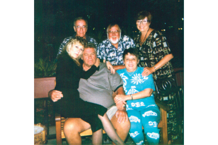 This is one of the only photos Anne Armour ever allowed us to print of her. Anne, seated at right, surrounded by friends and family, circa 2000.
