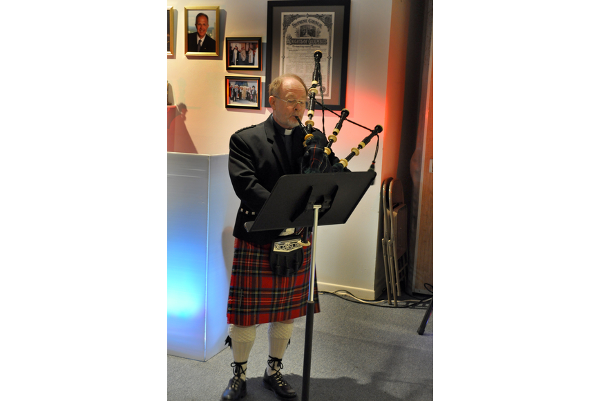 Father Dave Cottingham played traditional bagpipe songs.