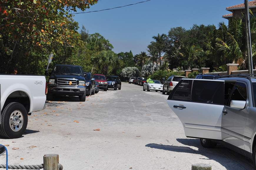 On busy days, cars crowd North Shell Road, making it difficut for residents to enter and leave their driveways.