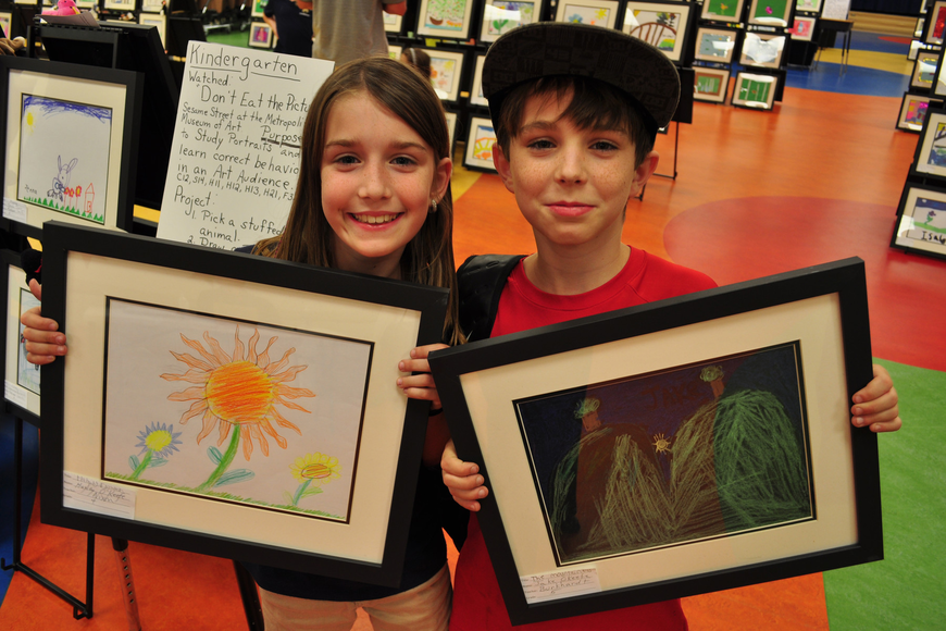 Hayley and Jake O'Keefe were eager to see their artwork framed.