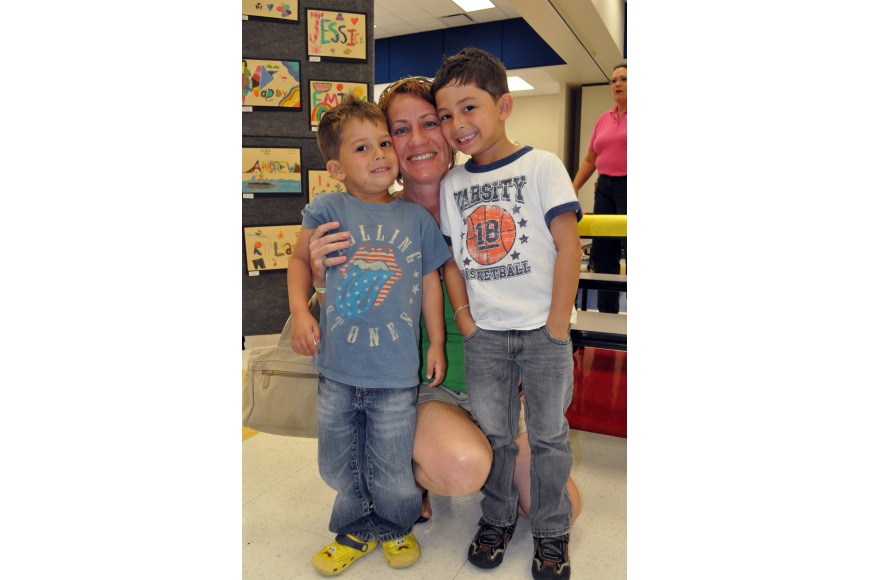 Betsy Serrano checked out the art show with her sons Jeshua, 3, and Dominico, 6.