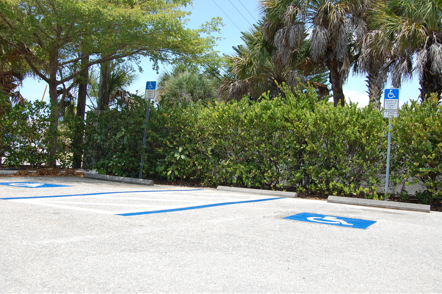 Fresh paint dries on regular and handicap parking spots in the Siesta Key Village parking lot.