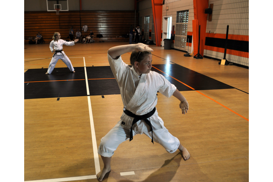 Jazmyn Friedman demonstrates her kata, which is a series of choreographed martial arts techniques.