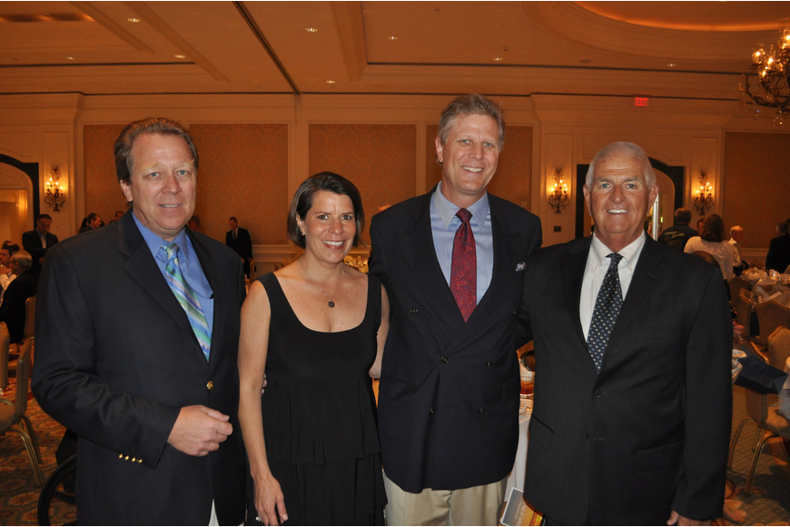 Chairs Chuck and Diann Flanders with president John Leeming and president elect Thomas Maryott
