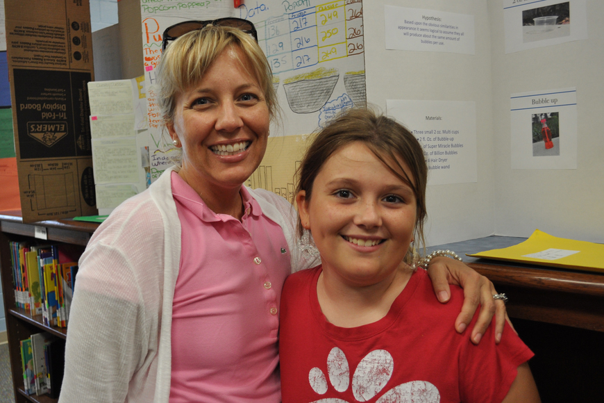 Libby Moser, pictured with her mom, Erin, received honorable mention for her bubble-blowing project.