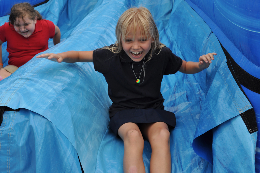 Kaylah Gunst didn't stop smiling as she went down the inflatable slide.