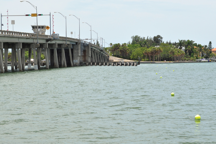Neon buoys mark the placement barriers designed to minimize the spread of construction debris across the bottom of Sarasota Bay.