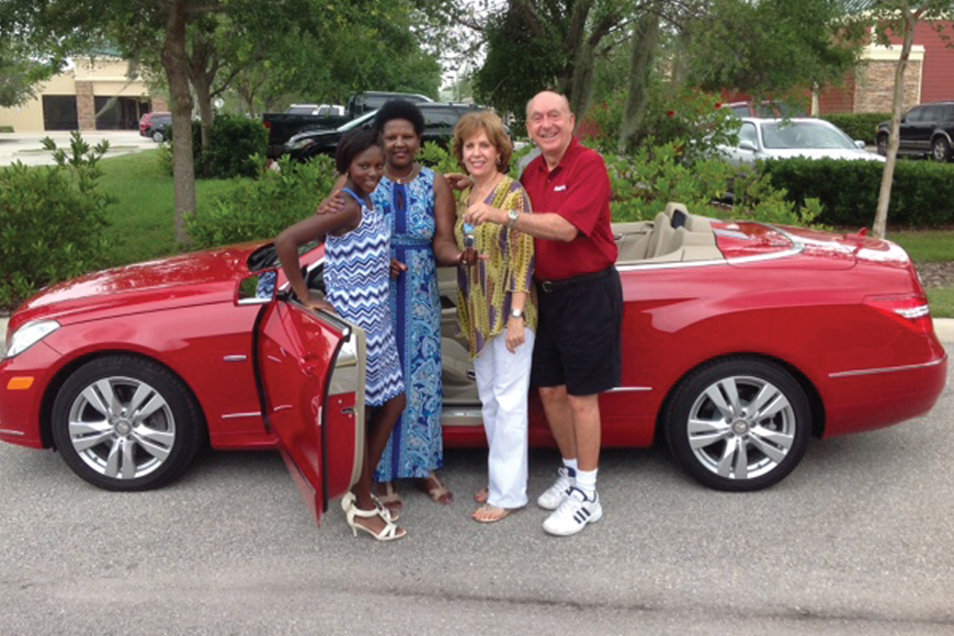 M'Balia and Cheryl Bangoura stand with the Bangouras' new convertible with Lorraine and Dick Vitale. Courtesy photo.
