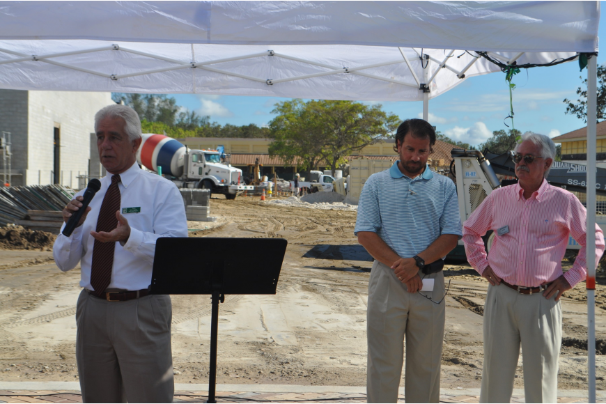 Publix Vice President of Lakeland Operations Tom McLaughlin, pictured with Publix agent Michael Leeds and Mayor Jim Brown speaks about the new store.