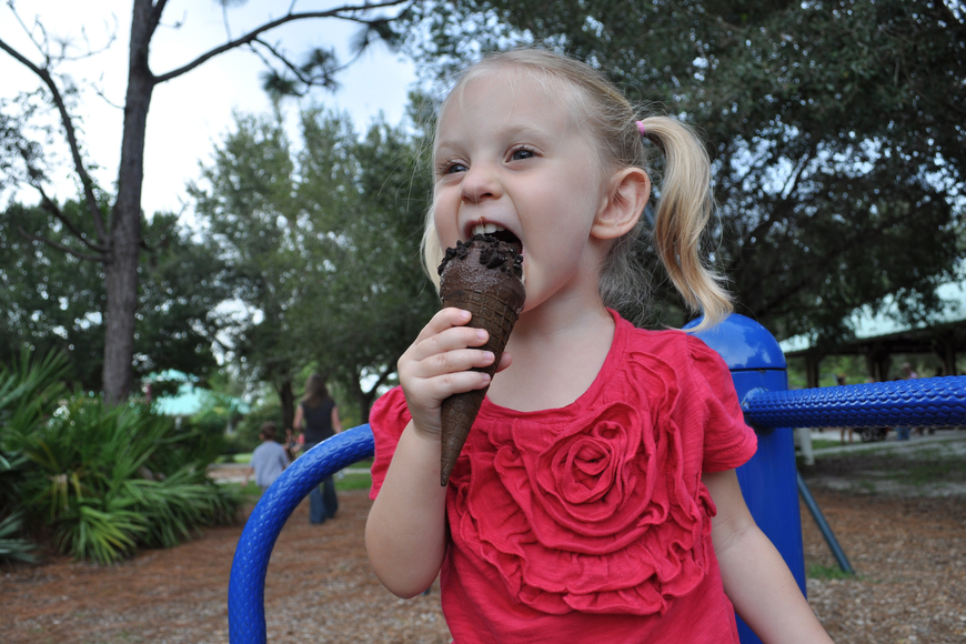 Madeline Gersh, 3, was more excited about eating her ice cream than playing.