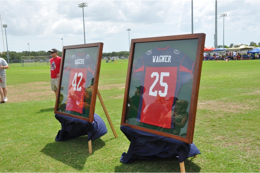 The families of Josh Rogers and Brett Wagner were presented with the boys' East Manatee Bulldogs jerseys.