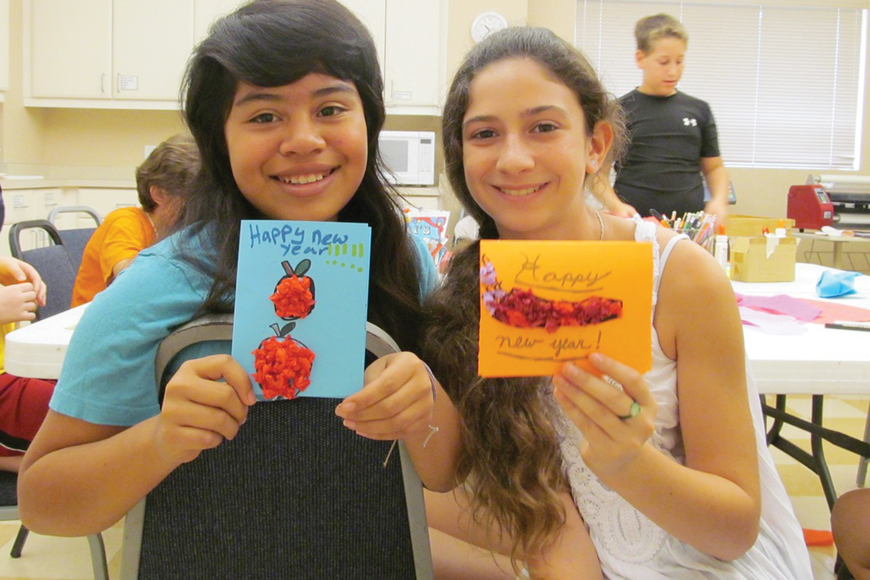 Mari Blumenthal and Lila Marlowe show off their New Year's cards. Courtesy photo.