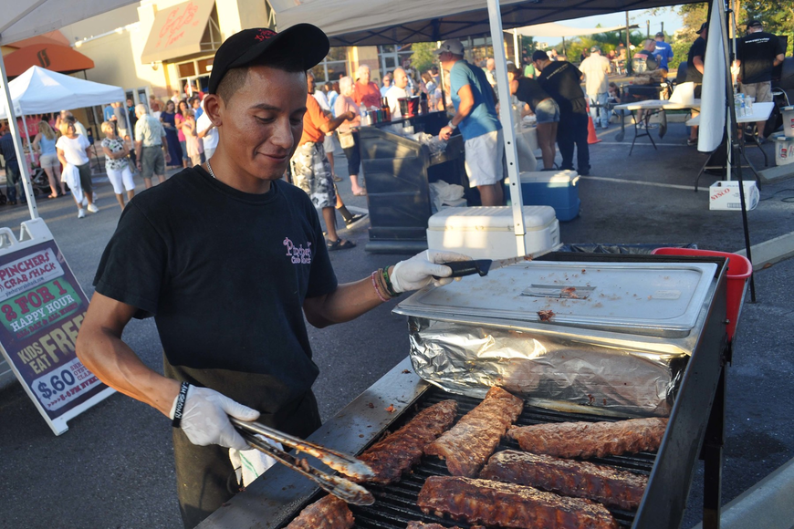 Luis de Jesus, of Pincher's Crab Shack, prepared ribs for the crowd.