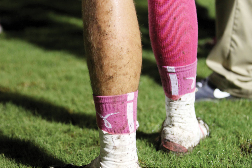 Lex Sayre, No. 15, was one of many Riverview players sporting pink socks to show support for National Breast Cancer Awareness Month. Photo by Rachel S. O'Hara.