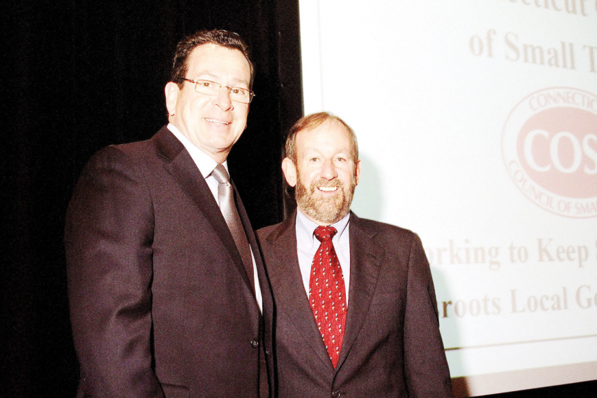 Connecticut Gov. Dannel Malloy honored Bart Russell at a recent reception organized by the Connecticut Council of Small Towns in honor of Russell's retirement. Courtesy.