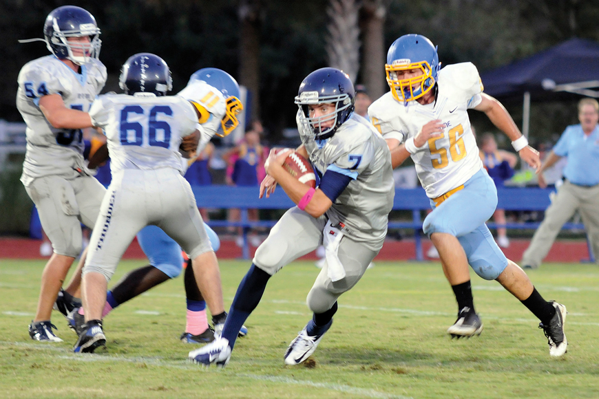 ODA quarterback Evan Wilson scrambles for yardage on the Thunder's opening possession.