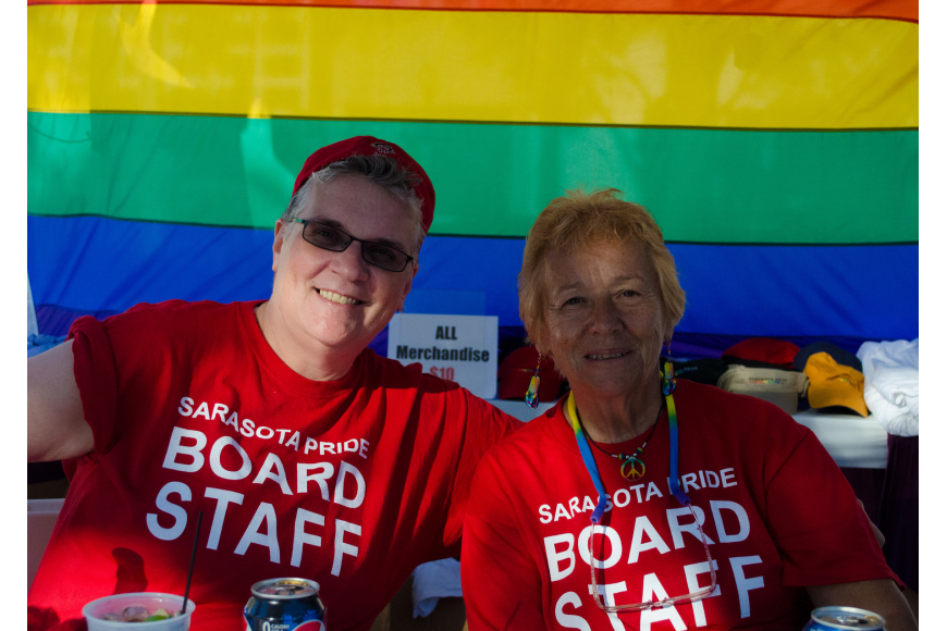 Susan Pringle and Glow Hoeft sell t-shirts to support Sarasota Pride.
