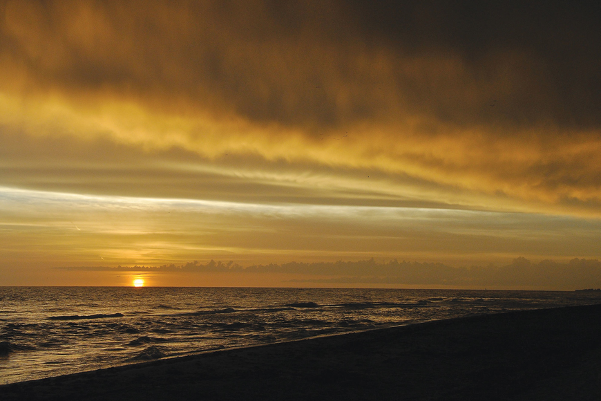 Lewis White took this sunset photo on Longboat Key as a rain shower moved on shore.
