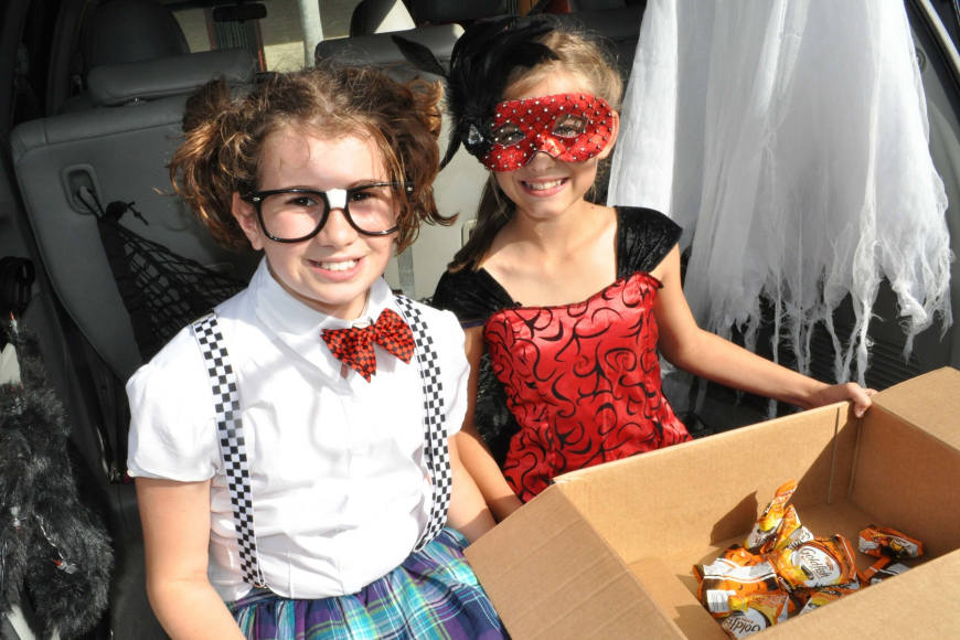 Leila Parks and Abigail Widunas passed out candy during the trunk-or-treat.