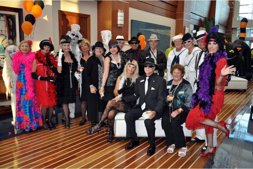 A group of Sarasota Yacht Club members dressed up in 1920s garb to celebrate the decade that the club was founded.