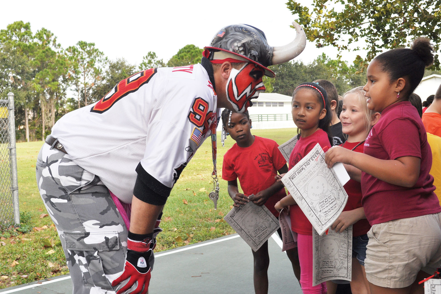 Before he warned students about the danger of drugs, Keith Kunzig, an NFL Hall of Fame member and crazed Tampa Bay Buccaneers fan, greeted kids individually.