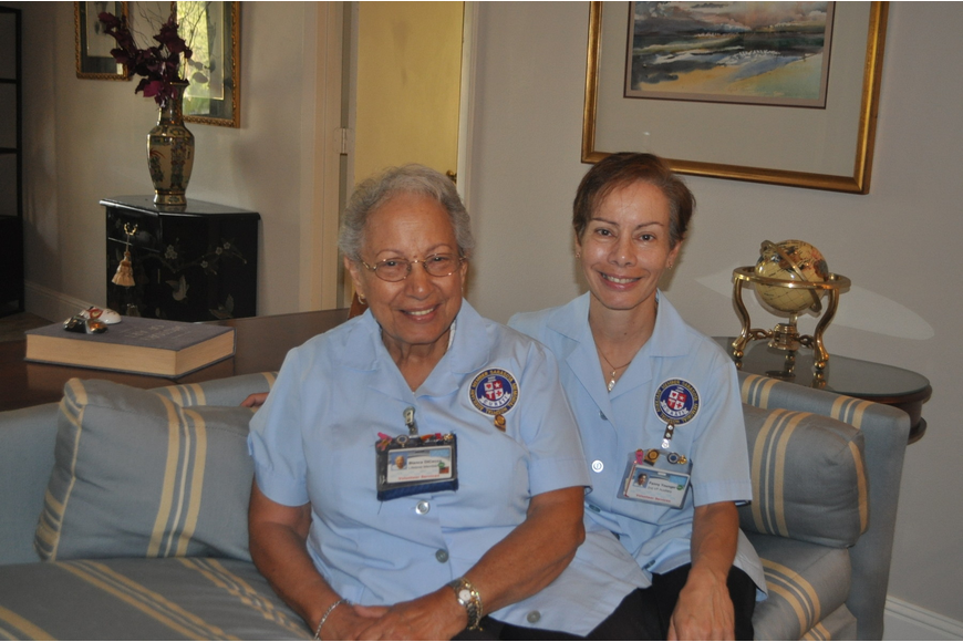 Blanca Di Cecco and her daughter, Fanny Younger, sport the smocks they wear while volunteering at Sarasota Memorial Hospital.