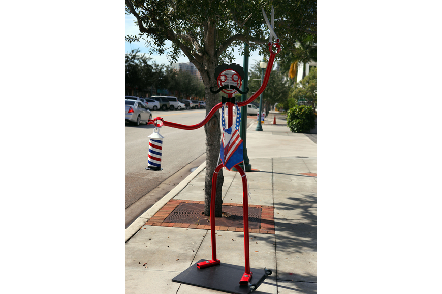 The Tube Dude outside of the Barber Shop on Main Street wore a patriotic, plastic vest Wednesday, Nov. 6, Election Day.