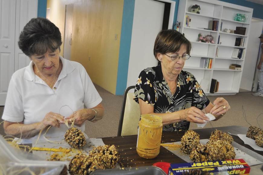 Joan Roecker and Betty Rahm get crafty as they prepare gift items for the Longboat Island Chapel bazaar.