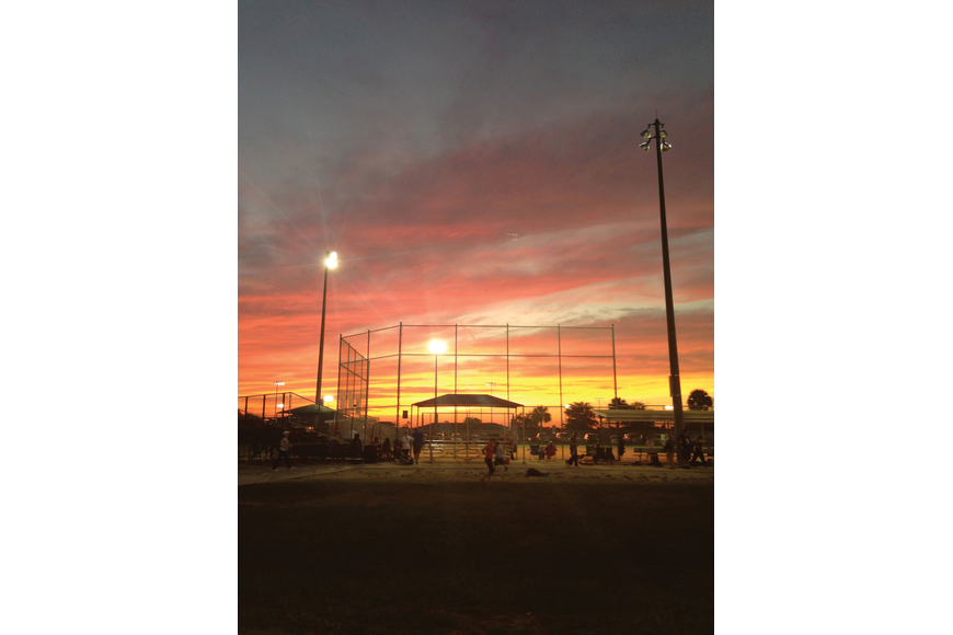 Maria Mercadante took this photo of the sun setting over a softball field.