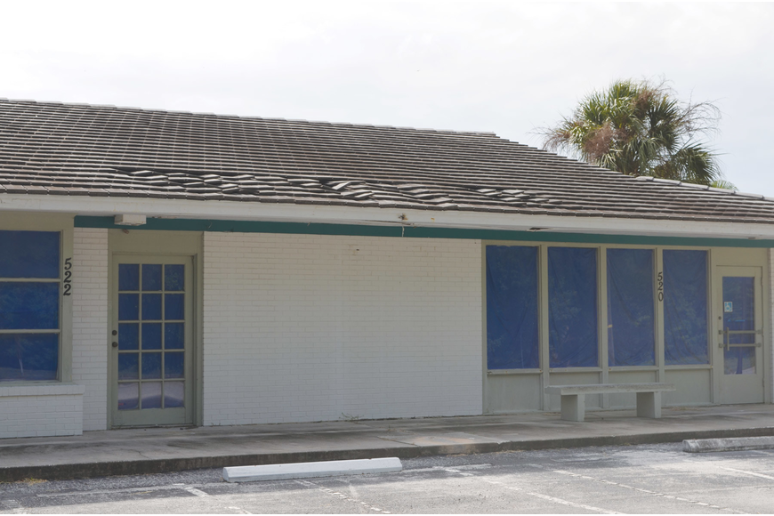 A caving roof in the post office building at Whitney Beach Plaza concerns town officials.