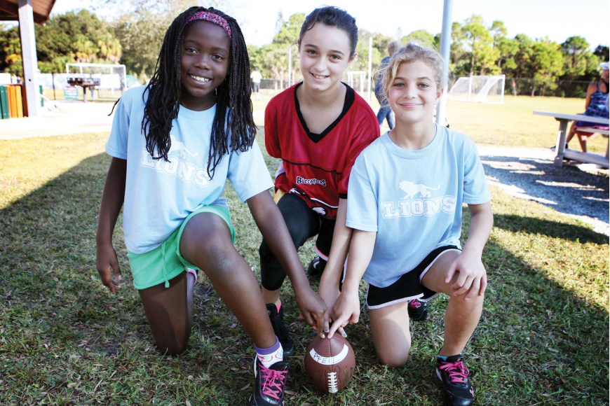 Bailey Saslow, 9, Chloe Delisle, 11, and Bianca Gruber, 9 1/2, pose together Saturday, Nov. 3, at Glebe Park. They are the only girls playing this season in the NFL Flag Football program that is offered through Suncoast Sports Club at Glebe Park.