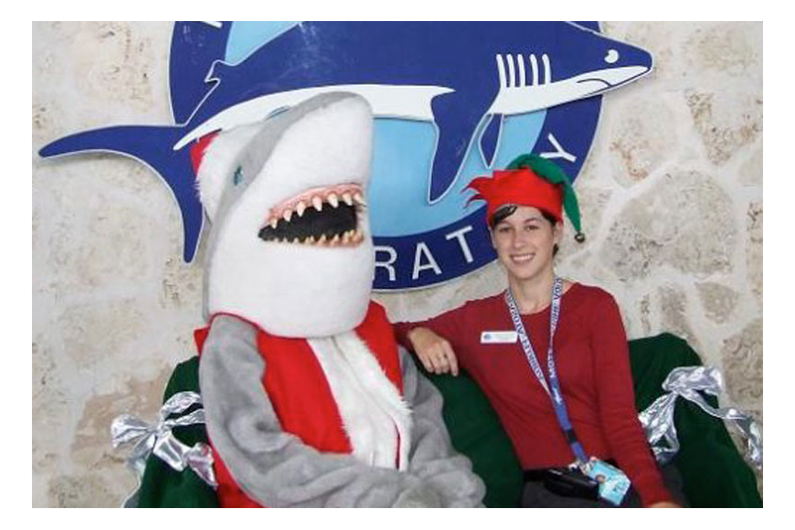 Gilly the Shark, aka Santa Jaws, with Mote Public Relations Coordinator Hayley Rutger.