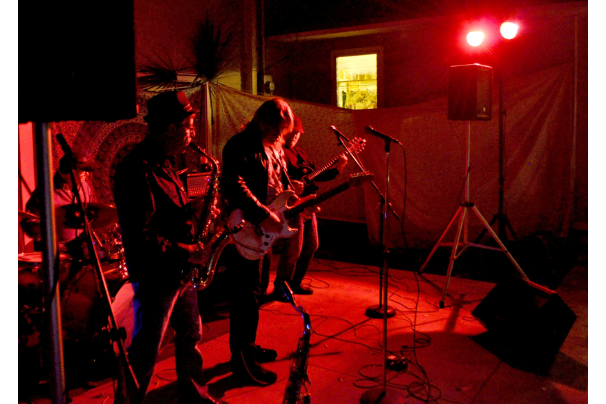 Members of the open jam band perform blues standards.
