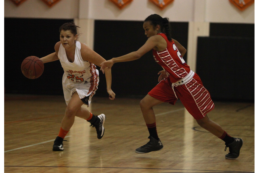 Sarah Bradtmueller, No. 25, drives the ball down the court as Manatee's Jasmine Luther, No. 23, tries to stop her Tuesday, Nov. 27, at Sarasota High School's gymnasium.