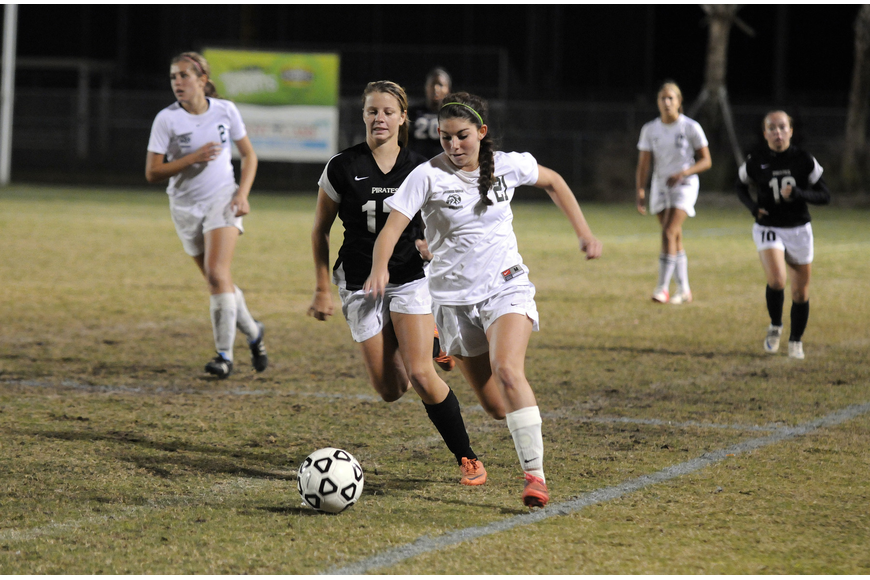 Lakewood Ranch junior midfielder Angelica Rego pushes the ball up the field.