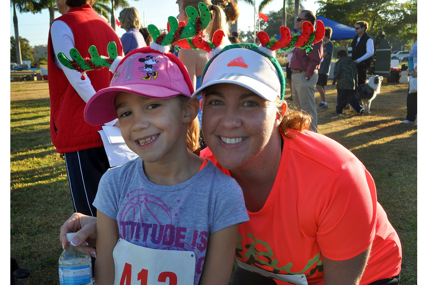 Erika Gonsalves, 7, and her mom, Lisa, wore colorful reindeer antler headbands for the 2nd Annual Achieva Reindeer Trot Saturday, Dec. 1, at Payne Park.