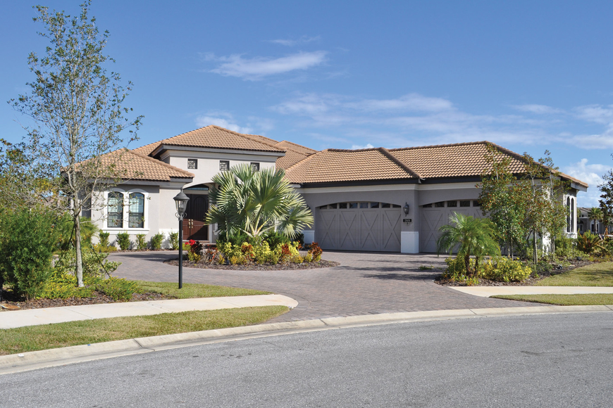 This Country Club East at Lakewood Ranch home, which has four bedrooms, four baths, a pool  and 3,588 square feet of iiving area, sold for $845,000. Josh Siegel.