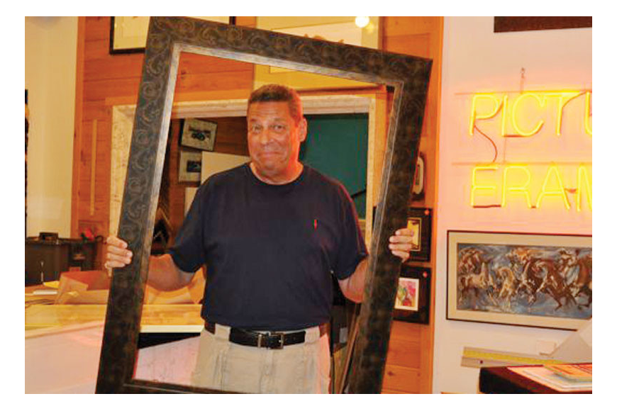 Terry Petesch, pictured in 2010, framed many prized possessions, in addition to artwork and photographs. File photo.
