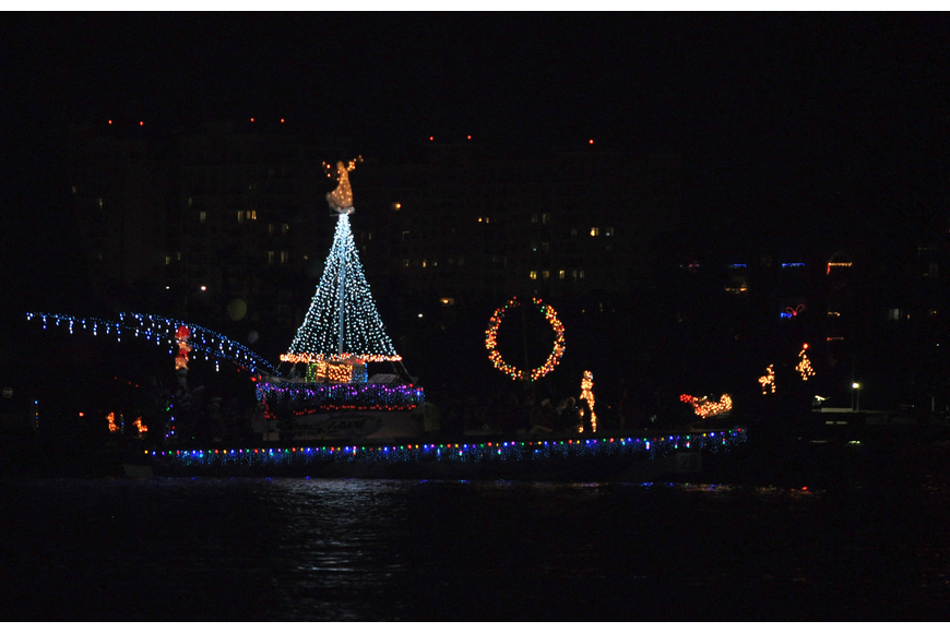 A Christmas tree with an angel on top, a wreath, Santa's sleigh and reindeer all made of lights made this boat shine on the water Saturday, Dec. 8, during the 26th Annual Sarasota Christmas Boat Parade.