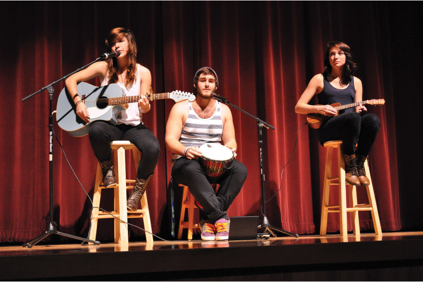 "Daphne VonCannon, Israel Olma and Lexi Moore perform ""Still Haven't Found What I'm Looking For"" during Braden River High School's Talent Show Nov. 29, in the school's auditorium. Published Dec. 6, 2012."
