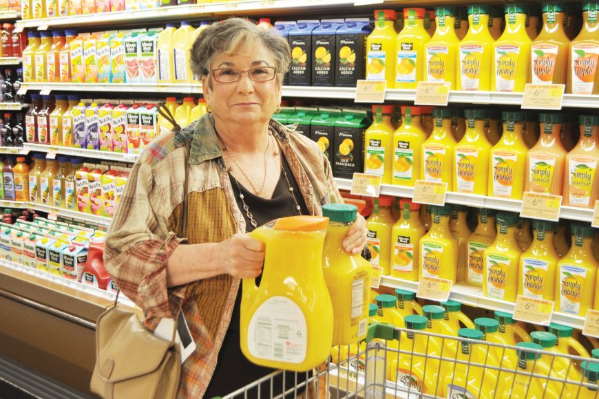 Joan Sinder, the first customer to walk through the doors of the new Publix, put bread in her cart before stocking up on orange juice.