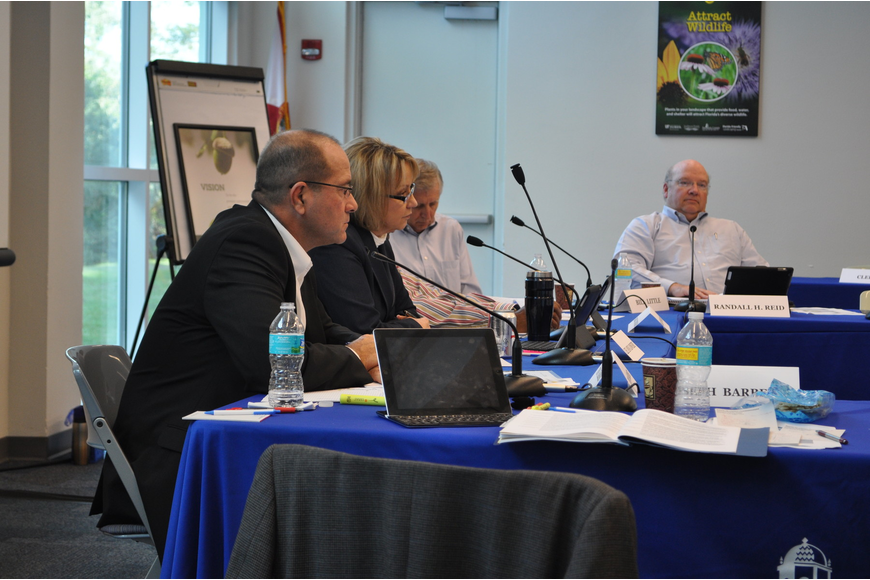 Assistant Sarasota County Administrators Tom Harmer, Lee Ann Lowery, and Mark Cunningham, and County Administrator Randall Reid confer with commissioners during a Dec. 7 retreat.